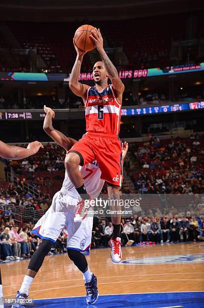 Eric Maynor of the Washington Wizards goes to the basket against the Philadelphia 76ers at the Wells Fargo Center on November 6 2013 in Philadelphia...