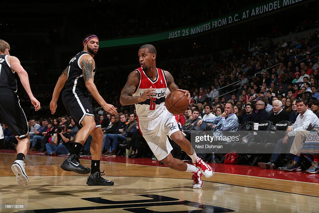 <a gi-track='captionPersonalityLinkClicked' href=/galleries/search?phrase=Eric+Maynor&family=editorial&specificpeople=4194194 ng-click='$event.stopPropagation()'>Eric Maynor</a> #6 of the Washington Wizards handles the ball against the Brooklyn Nets at the Verizon Center on November 8, 2013 in Washington, DC.
