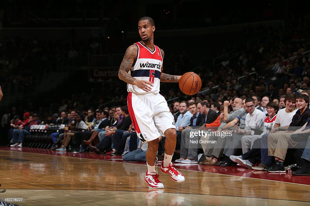 <a gi-track='captionPersonalityLinkClicked' href=/galleries/search?phrase=Eric+Maynor&family=editorial&specificpeople=4194194 ng-click='$event.stopPropagation()'>Eric Maynor</a> #6 of the Washington Wizards looks to pass the ball against the Minnesota Timberwolves during the game at the Verizon Center on November 19, 2013 in Washington, DC.