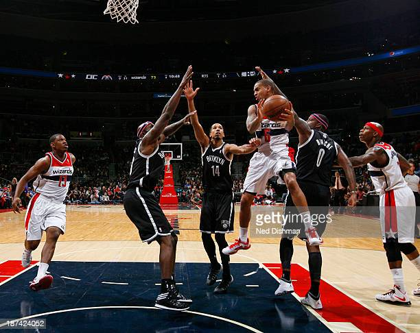 Eric Maynor of the Washington Wizards passes against the Brooklyn Nets during the game at the Verizon Center on November 8 2013 in Washington DC NOTE...