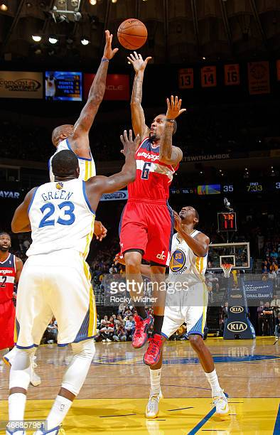 Eric Maynor of the Washington Wizards shoot against Marreese Speights of the Golden State Warriors on January 28 2014 at Oracle Arena in Oakland...