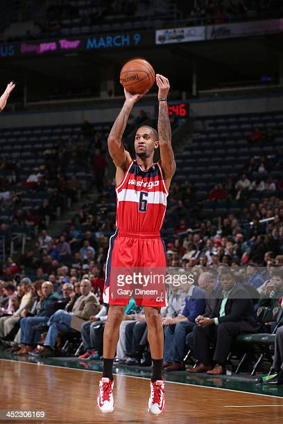 Eric Maynor of the Washington Wizards shoots against the Milwaukee Bucks on November 27 2013 at the BMO Harris Bradley Center in Milwaukee Wisconsin...