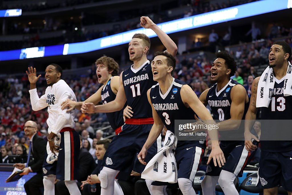 Eric McClellan #23, Kyle Wiltjer #33, Domantas Sabonis #11, Kyle Dranginis #3, Silas Melson #0 and Josh Perkins #13 of the Gonzaga Bulldogs celebrate from the bench late in the second half against the Utah Utes during the second round of the 2016 NCAA Men's Basketball Tournament at the Pepsi Center on March 19, 2016 in Denver, Colorado.