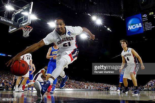 Eric McClellan of the Gonzaga Bulldogs tries to save the ball from going out of bounds in the second half against the UCLA Bruins during a South...