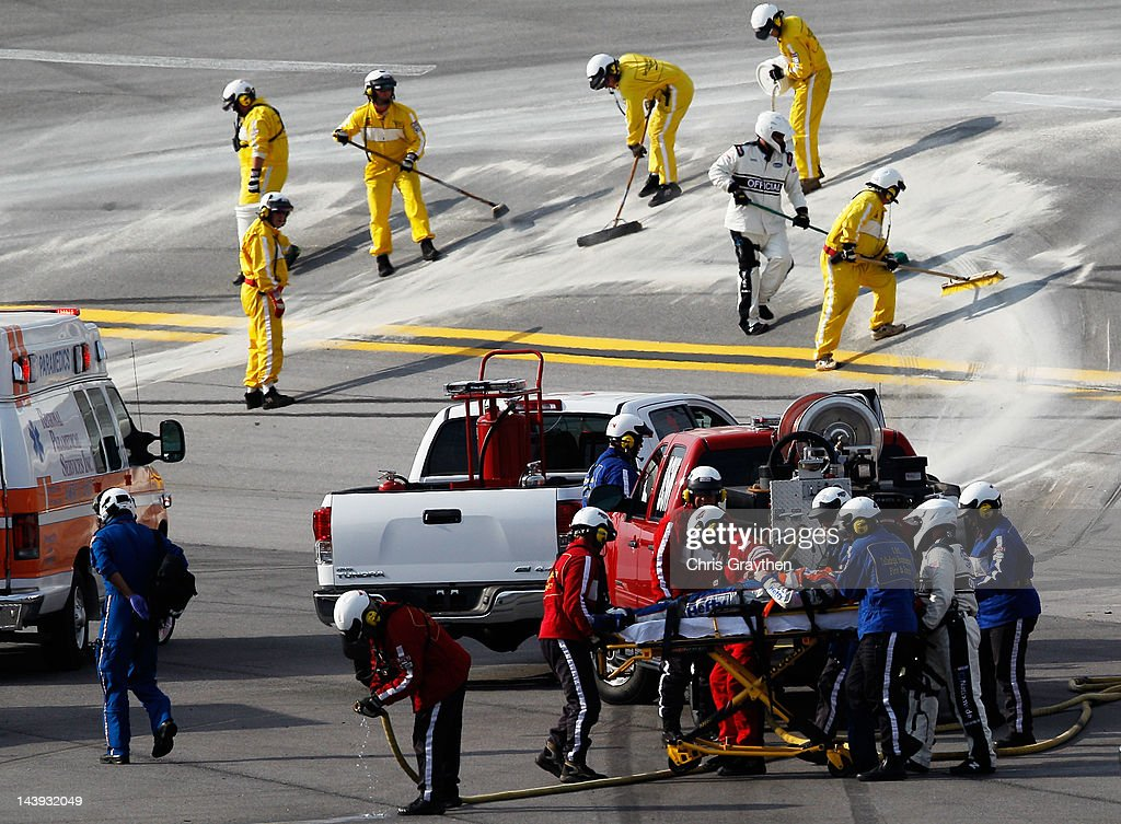 Eric McClure, driver of the #14 Hefty/Reynolds Wrap Toyota, receives attention from a medical team after an incident during the NASCAR Nationwide Series Aaron's 312 at Talladega Superspeedway on May 5, 2012 in Talladega, Alabama.