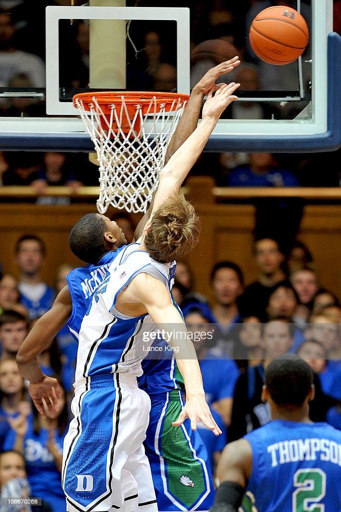 Eric McKnight #12 of the Florida Gulf Coast Eagles blocks a shot by Alex Murphy #12 of the Duke Blue Devils at Cameron Indoor Stadium on November 18, 2012 in Durham, North Carolina. Duke defeated Florida Gulf Coast 88-67.