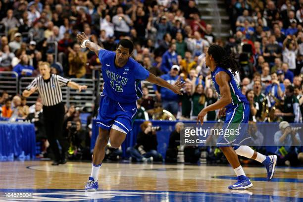 Eric McKnight of the Florida Gulf Coast Eagles celebrates in the second half while taking on the San Diego State Aztecs during the third round of the...