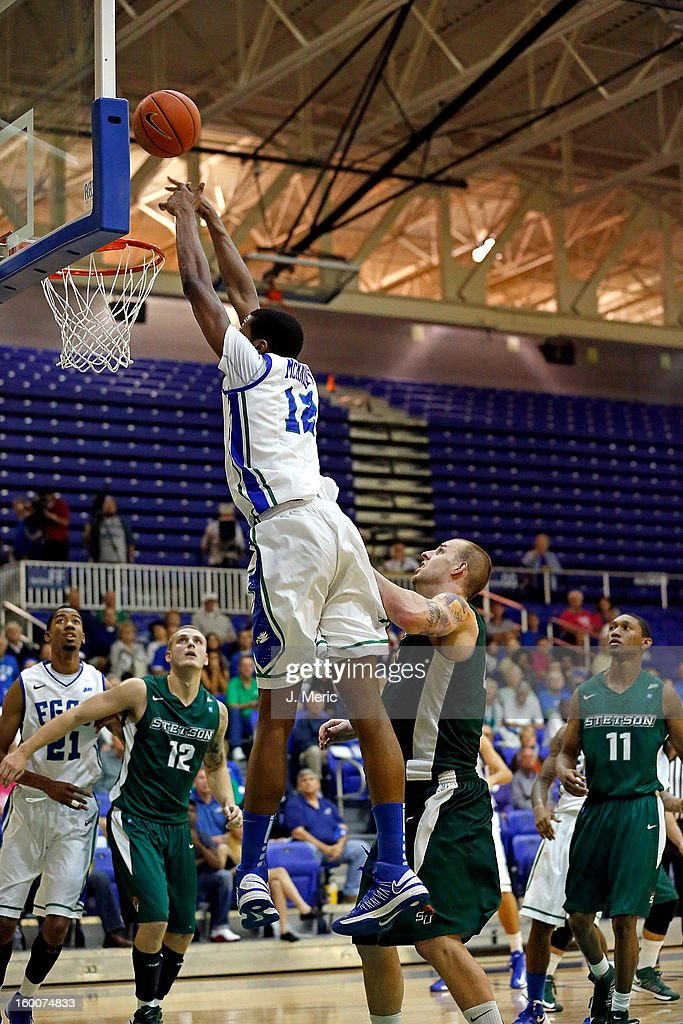 Eric McKnight #12 of the Florida Gulf Coast University Eagles loses the pass against the Stetson Hatters during the game at Alico Arena on January 25, 2013 in Ft. Myers, Florida.