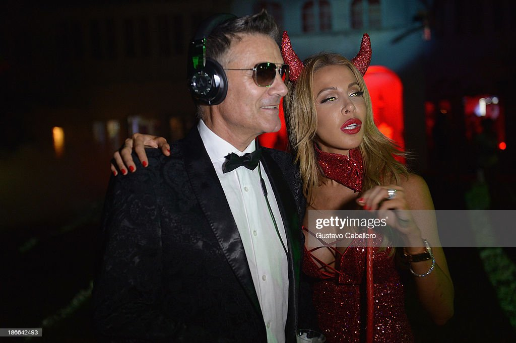 Eric Milon and Lisa Hochstein attends Lisa Hochstein of 'Real Housewives of Miami' and Lenny Hochstein's Halloween Ball benefitting the Make-A-Wish Foundation on November 1, 2013 in Miami Beach, Florida.