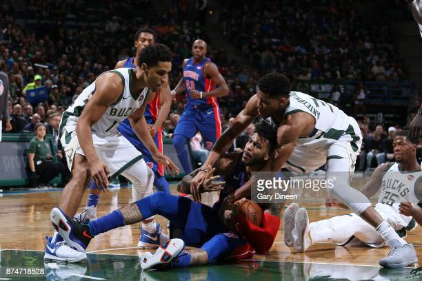 Eric Moreland of the Detroit Pistons battles for possession against Giannis Antetokounmpo and Malcolm Brogdon of the Milwaukee Bucks on November 15...