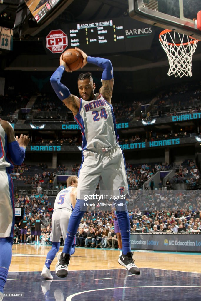 Eric Moreland #24 of the Detroit Pistons grabs the rebound against the Charlotte Hornets on February 25, 2018 at Spectrum Center in Charlotte, North Carolina.