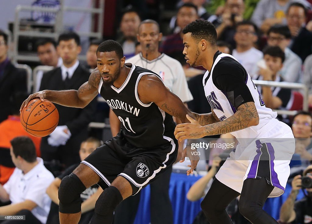 <a gi-track='captionPersonalityLinkClicked' href=/galleries/search?phrase=Eric+Moreland&family=editorial&specificpeople=8679310 ng-click='$event.stopPropagation()'>Eric Moreland</a> #25 of the Sacramento Kings defends against <a gi-track='captionPersonalityLinkClicked' href=/galleries/search?phrase=Cory+Jefferson&family=editorial&specificpeople=8783017 ng-click='$event.stopPropagation()'>Cory Jefferson</a> #21 of the Brooklyn Nets during the game between the Brooklyn Nets and the Sacramento Kings as part of the 2014 NBA Global Games at the MasterCard Center on October 15, 2014 in Beijing, China.