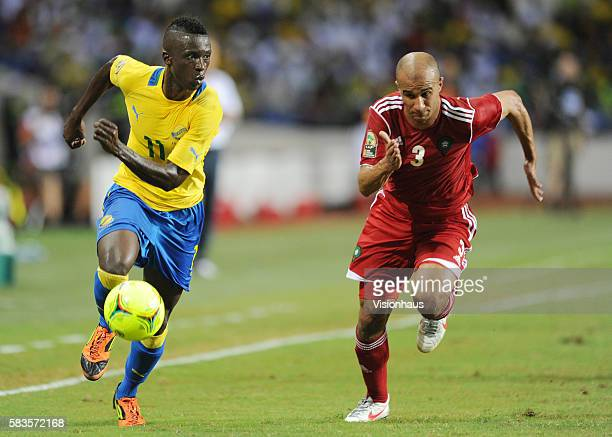 Eric Mouloungui of Gabon and Badr El Kaddouri of Morocco during the 2012 African Cup of Nations Group C match between Gabon and Morocco at the Stade...