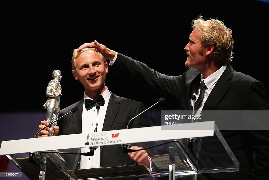 Eric Murray (R) and Hamish Bond (L) accept the overall Halberg Award during the 2013 Halberg Awards at Vector Arena on February 14, 2013 in Auckland, New Zealand.