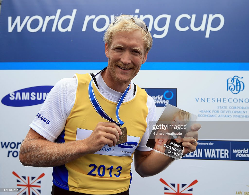 Eric Murray of New Zealand wishes his wife happy birthday as he celebrates victory in the Men's Pair final during the third day of the 2013 Samsung World Rowing Cup II at Eton Dorney on June 23, 2013 in Windsor, England.