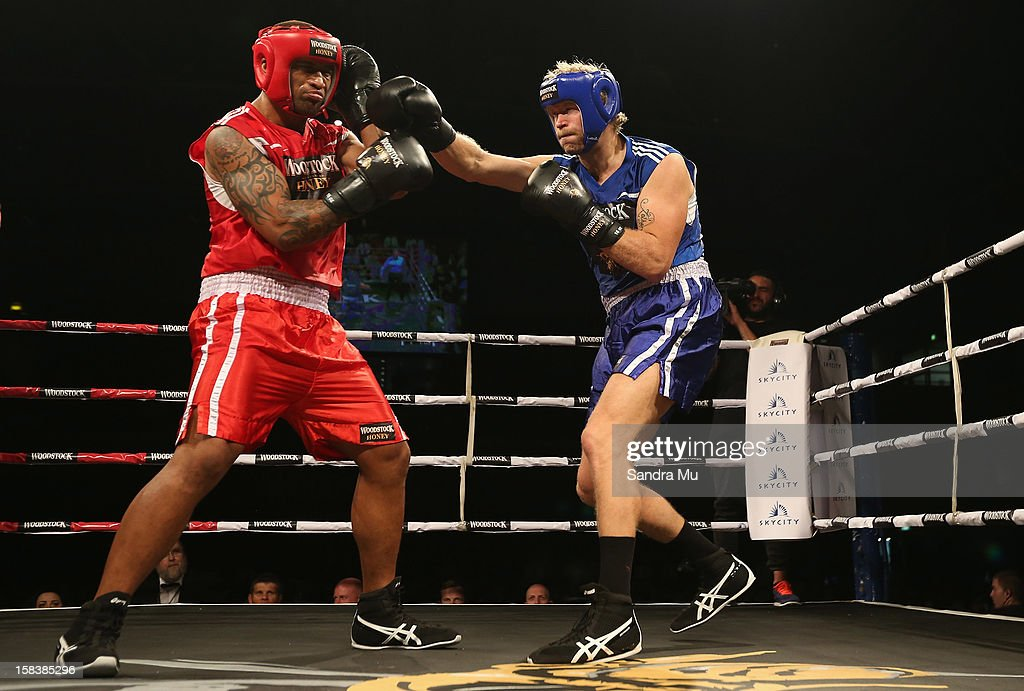 Eric Murray of rowing (R) punches Manu Vatuvei of league during the bout between Eric Murray and Manu Vatuvei during the 2012 Fight for Life at Trusts Stadium on December 15, 2012 in Auckland, New Zealand.