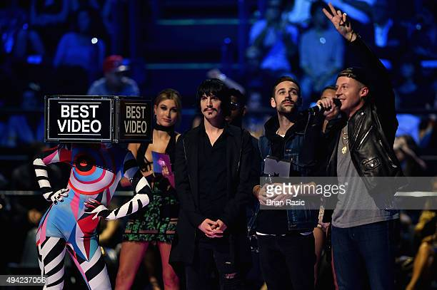 Eric Nally Ryan Lewis and Macklemore accept the award for Best Video for ''Downtown'' on stage during the MTV EMA's 2015 at the Mediolanum Forum on...