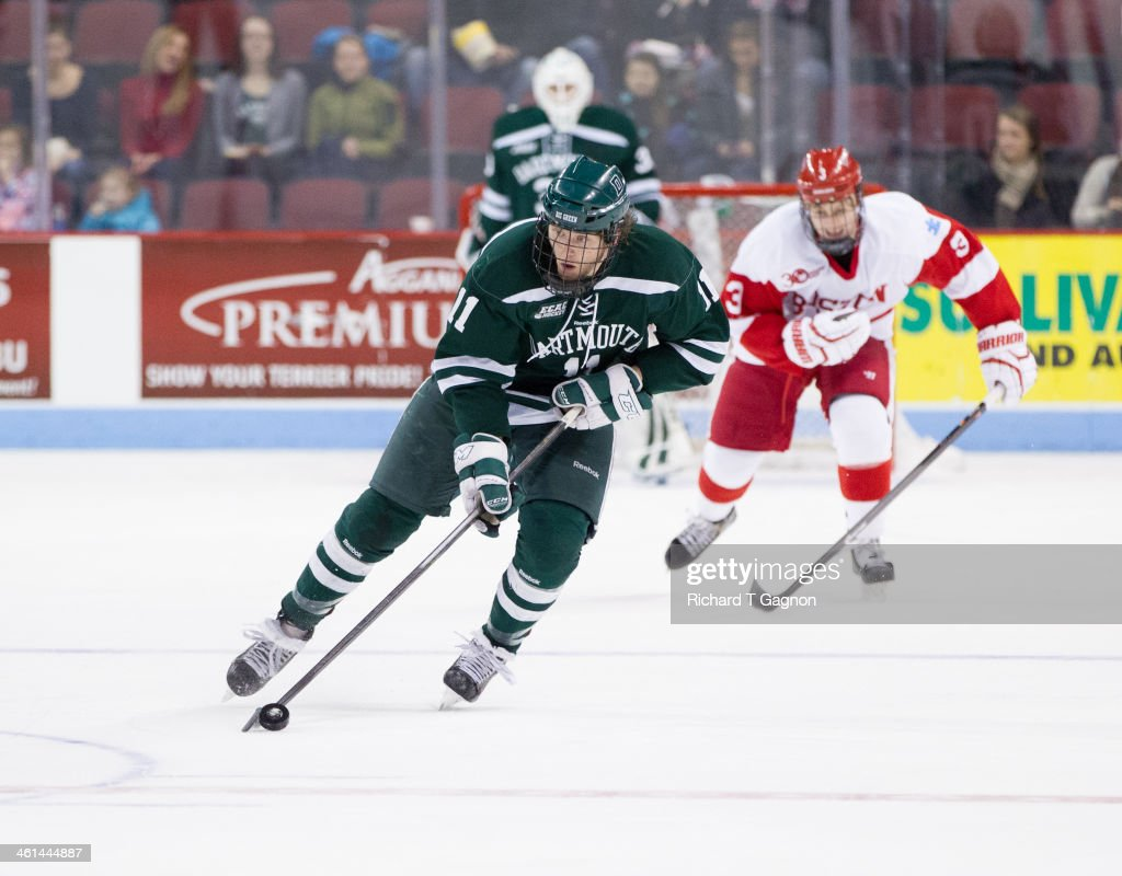 Eric Neiley #11 of the Dartmouth College Big Green controls the puck skates against the Dartmouth Big Green during NCAA hockey action at Agganis Arena on January 8, 2014 in Boston, Massachusetts.
