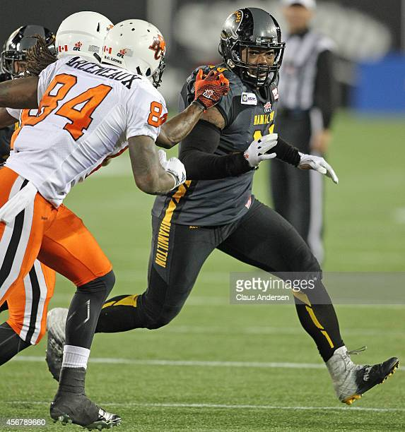 Eric Norwood of the Hamilton Tigercats runs to make a stop against the BC Lions in a CFL football game at Tim Hortons Field on October 4 2014 in...