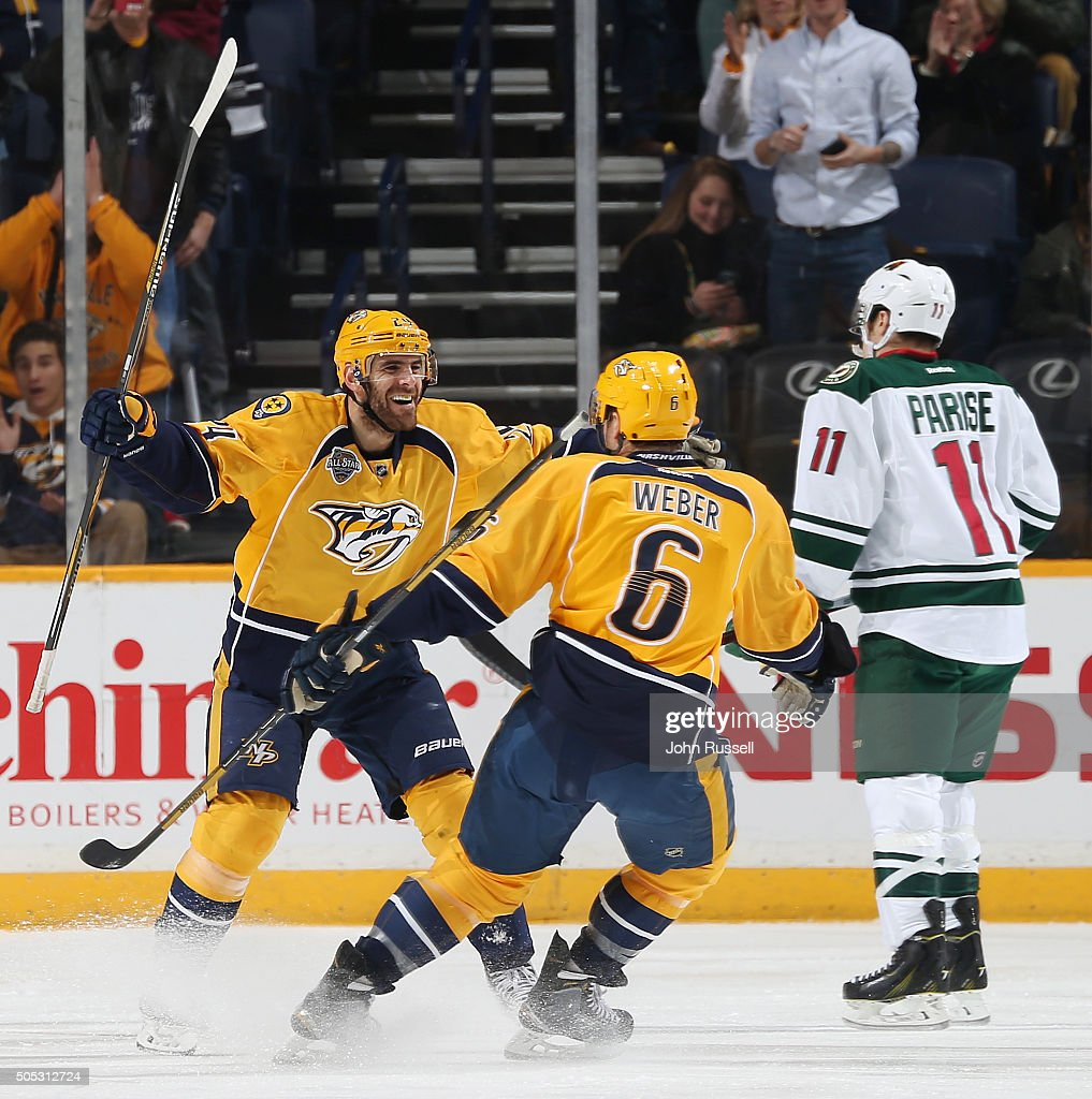 Eric Nystrom celebrates his goal with Shea Weber of the Nashville Predators against the Minnesota Wild during an NHL game at Bridgestone Arena on...