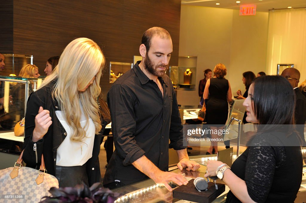 Eric Nystrom looks at jewelry from the Men's Forged Carbon Collection at an InStore Event hosted by Matt Cullen To Celebrate The Launch Of The Men's...