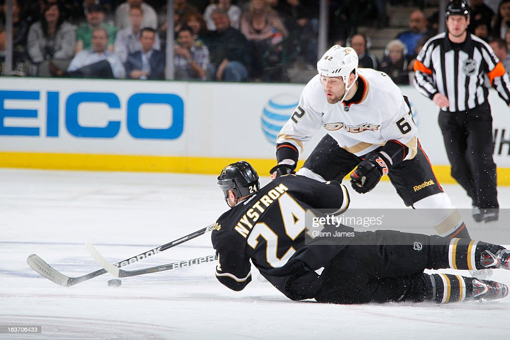 <a gi-track='captionPersonalityLinkClicked' href=/galleries/search?phrase=Eric+Nystrom&family=editorial&specificpeople=2209813 ng-click='$event.stopPropagation()'>Eric Nystrom</a> #24 of the Dallas Stars dives to block a shot against Patrick Maroon #62 of the Anaheim Ducks at the American Airlines Center on March 14, 2013 in Dallas, Texas.