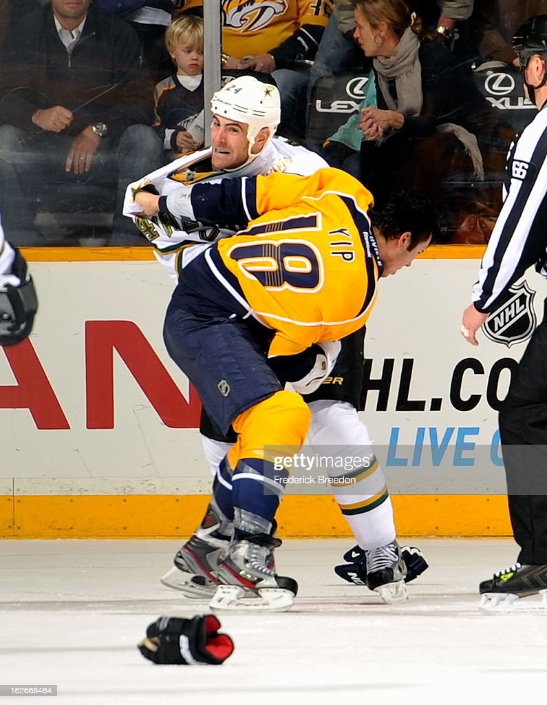 Eric Nystrom of the Dallas Stars fights Brandon Yip of the Nashville Predators at the Bridgestone Arena on February 25 2013 in Nashville Tennessee