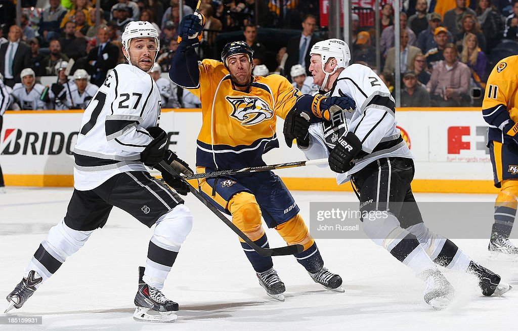 Eric Nystrom #24 of the Nashville Predators battles for position against Matt Greene #2 and Alec Martinez #27 of the Los Angeles Kings at Bridgestone Arena on October 17, 2013 in Nashville, Tennessee.