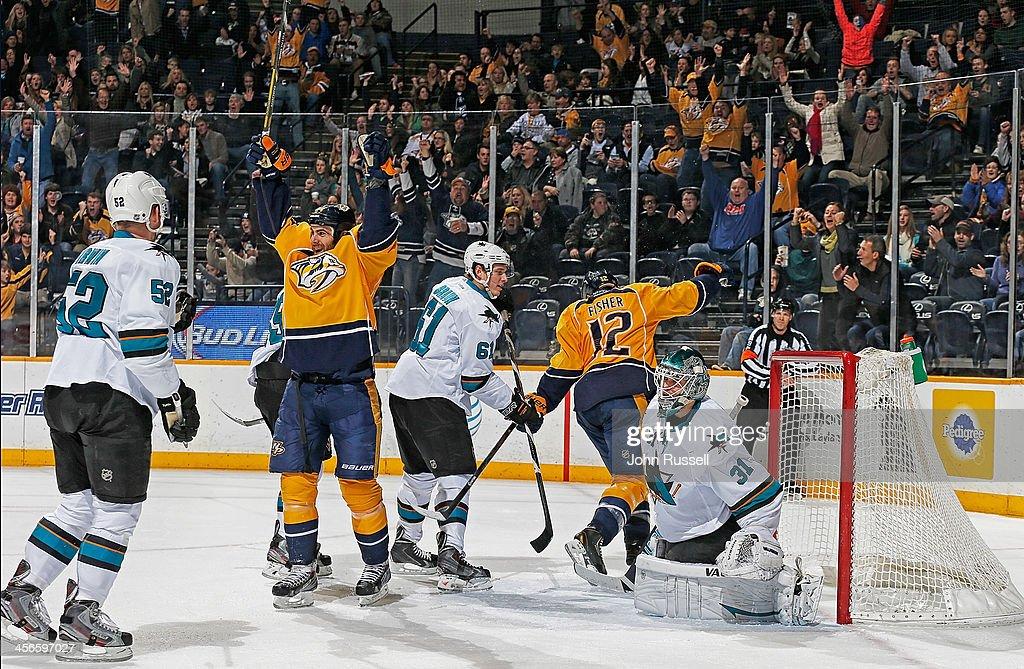 Eric Nystrom of the Nashville Predators celebrates his goal against Antti Niemi of the San Jose Sharks at Bridgestone Arena on December 14 2013 in...
