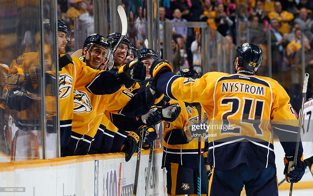 Eric Nystrom of the Nashville Predators celebrates his goal with the bench against the Anaheim Ducks during an NHL game at Bridgestone Arena on...