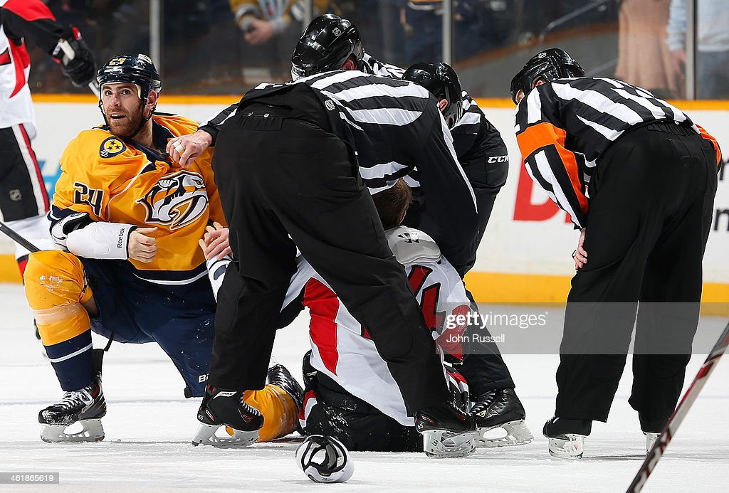 Eric Nystrom of the Nashville Predators is separated from JeanGabriel Pageau of the Ottawa Senators after a fight at Bridgestone Arena on January 11...