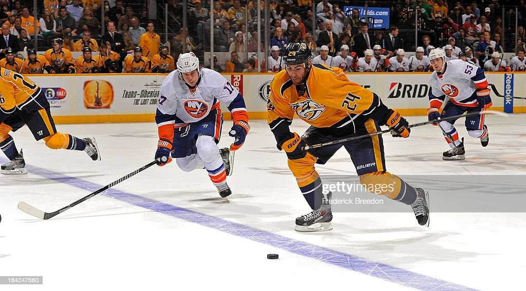 <a gi-track='captionPersonalityLinkClicked' href=/galleries/search?phrase=Eric+Nystrom&family=editorial&specificpeople=2209813 ng-click='$event.stopPropagation()'>Eric Nystrom</a> #24 of the Nashville Predators skates against Matt Martin #17 of the New York Islanders at Bridgestone Arena on October 12, 2013 in Nashville, Tennessee.