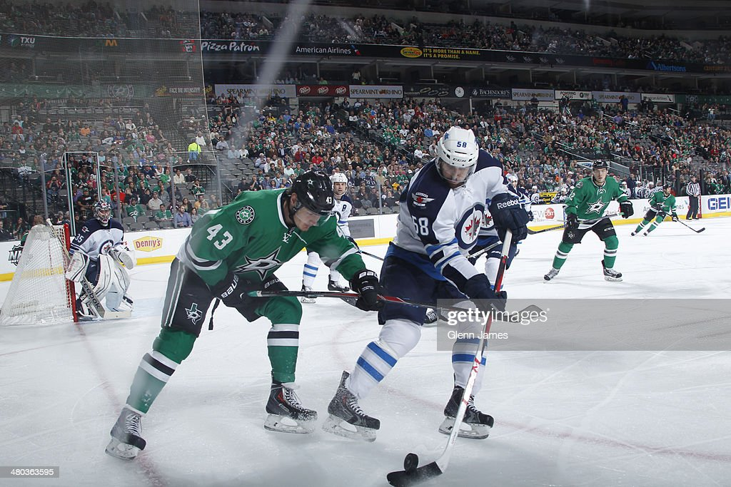 Eric O'Dell #58 of the Winnipeg Jets handles the puck against <a gi-track='captionPersonalityLinkClicked' href=/galleries/search?phrase=Valeri+Nichushkin&family=editorial&specificpeople=8615473 ng-click='$event.stopPropagation()'>Valeri Nichushkin</a> #43 of the Dallas Stars at the American Airlines Center on March 24, 2014 in Dallas, Texas.