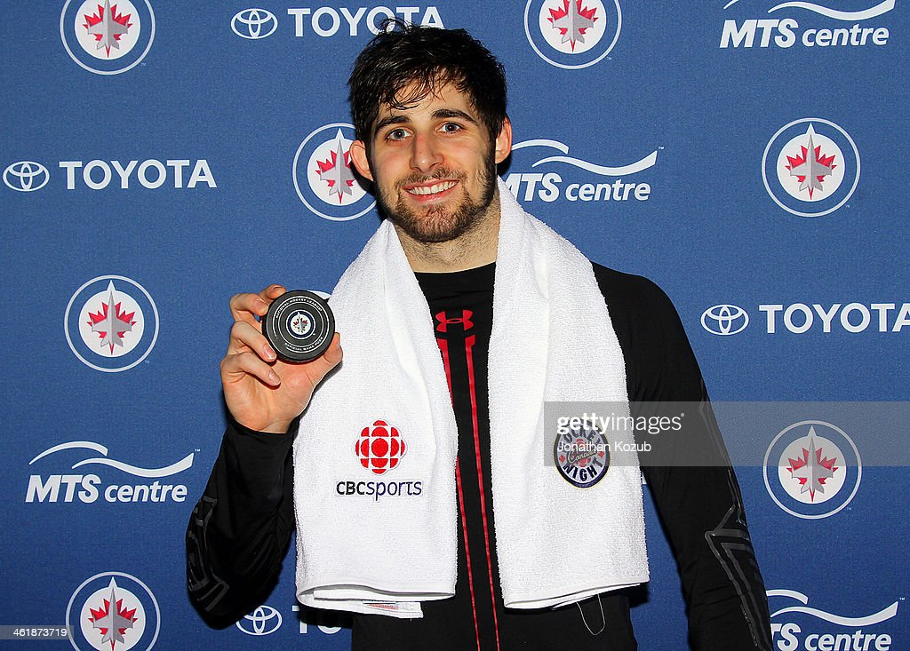 Eric O'Dell #58 of the Winnipeg Jets poses with the puck from his first career NHL goal in a game against the Columbus Blue Jackets at the MTS Centre on January 11, 2014 in Winnipeg, Manitoba, Canada.