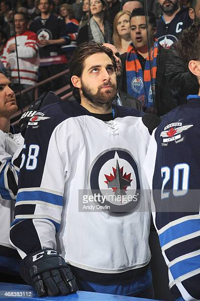 Eric O'Dell of the Winnipeg Jets stands for the singing of the national anthem prior to the game against the Edmonton Oilers on March 23 2015 at...