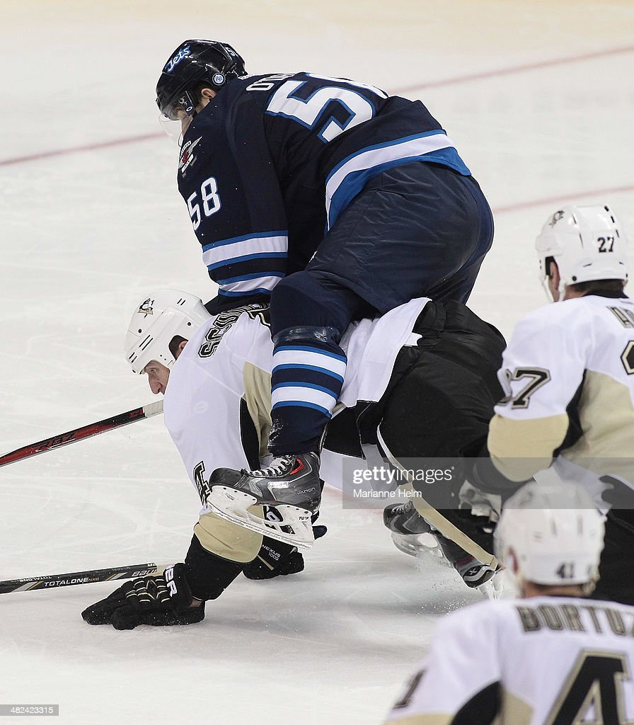 Eric O'Dell #58 of the Winnipeg Jets tries to get over the top of <a gi-track='captionPersonalityLinkClicked' href=/galleries/search?phrase=Rob+Scuderi&family=editorial&specificpeople=228124 ng-click='$event.stopPropagation()'>Rob Scuderi</a> #4 of the Pittsburgh Penguins in third period action in an NHL game at the MTS Centre on April 3, 2014 in Winnipeg, Manitoba, Canada.