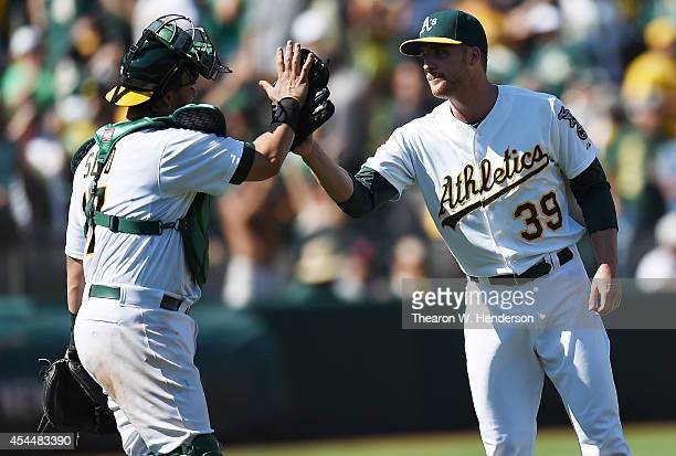Eric O'Flaherty and Geovany Soto of the Oakland Athletics celebrates a 61 win over the Seattle Mariners at Oco Coliseum on September 1 2014 in...