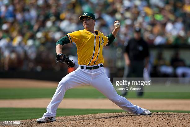 Eric O'Flaherty of the Oakland Athletics pitches against the Baltimore Orioles during the eighth inning at Oco Coliseum on July 20 2014 in Oakland...
