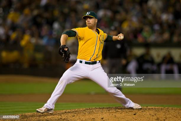 Eric O'Flaherty of the Oakland Athletics pitches against the Kansas City Royals during the eighth inning at Oco Coliseum on August 1 2014 in Oakland...