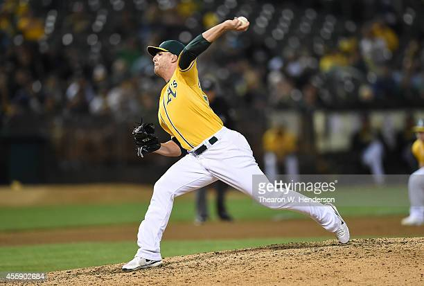 Eric O'Flaherty of the Oakland Athletics pitches against the Texas Rangers at Oco Coliseum on September 16 2014 in Oakland California