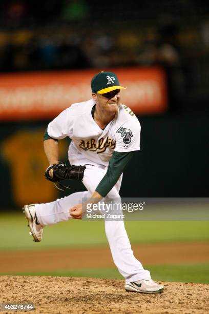 Eric O'Flaherty of the Oakland Athletics pitches during the game against the Baltimore Orioles at Oco Coliseum on July 18 2014 in Oakland California...