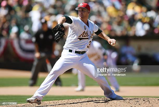 Eric O'Flaherty of the Oakland Athletics pitches in the top of the seventh inning against the Toronto Blue Jays at Oco Coliseum on July 4 2014 in...
