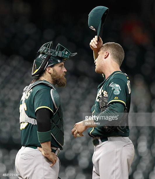 Eric O'Flaherty of the Oakland Athletics talks with catcher Derek Norris of the Oakland Athletics at Minute Maid Park on August 25 2014 in Houston...