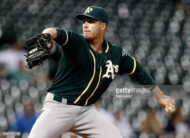 Eric O'Flaherty of the Oakland Athletics throws in the ninth inning against the Houston Astros at Minute Maid Park on August 25 2014 in Houston Texas