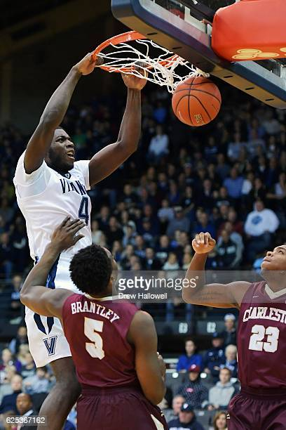 Eric Paschall of the Villanova Wildcats dunks against Jarrell Brantley and Nick Harris of the Charleston Cougars at The Pavilion on November 23 2016...
