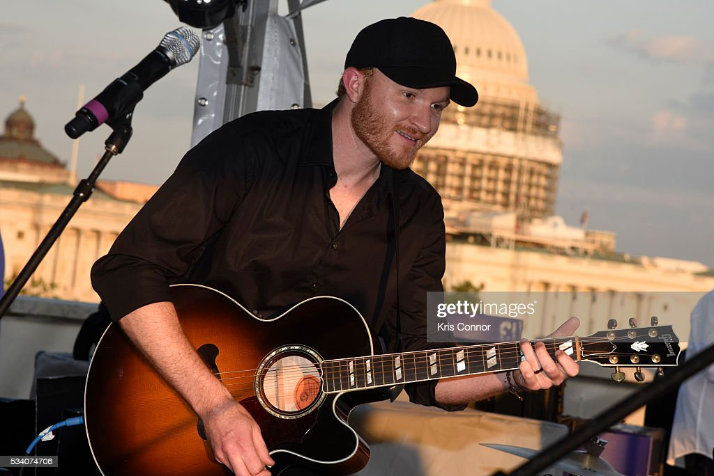 <a gi-track='captionPersonalityLinkClicked' href=/galleries/search?phrase=Eric+Paslay&family=editorial&specificpeople=7334593 ng-click='$event.stopPropagation()'>Eric Paslay</a> perform during the NAMM TurnAround Arts Artist Reception at Nelson Mullins on May 24, 2016 in Washington DC.