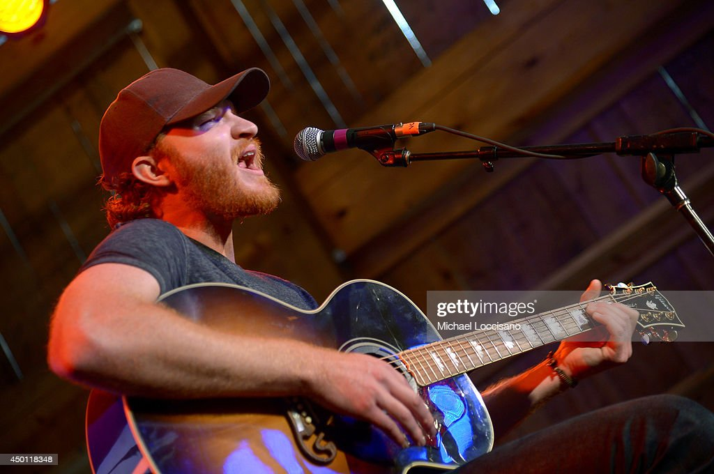 Eric Paslay performs at HGTVs The Lodge at CMA Music Fest 2014 on June 5 2014 in Nashville Tennessee