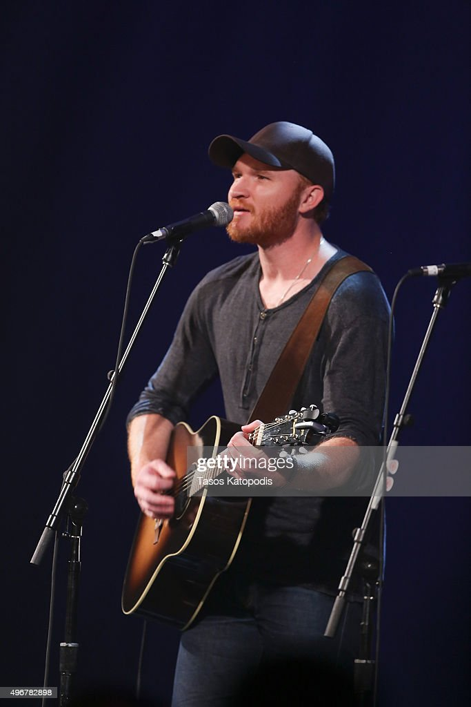 Eric Paslay performs during the CBS Radio Present Stars Strings on November 11 2015 in Chicago Illinois