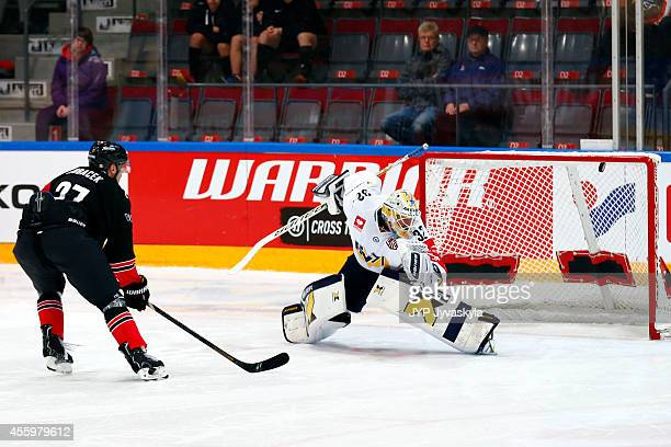 Eric Perrin of JYP celebrates the game winning goal by penalty during the Champions Hockey League group stage game between JYP Jyvaskyla and HV71...