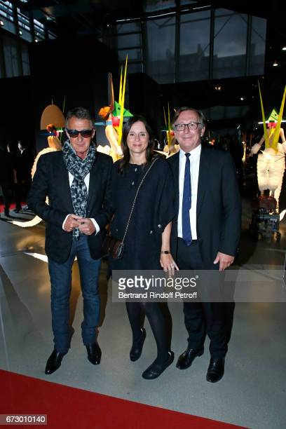 Eric Pfrunder Bruno pavlovsky and his wife Nathalie pose in front the works of JeanPaul Goude during the 'Societe des Amis du Musee d'Art Moderne du...